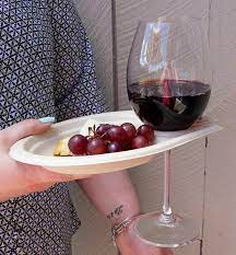 Paper plate that has a hole to hold a wine glass