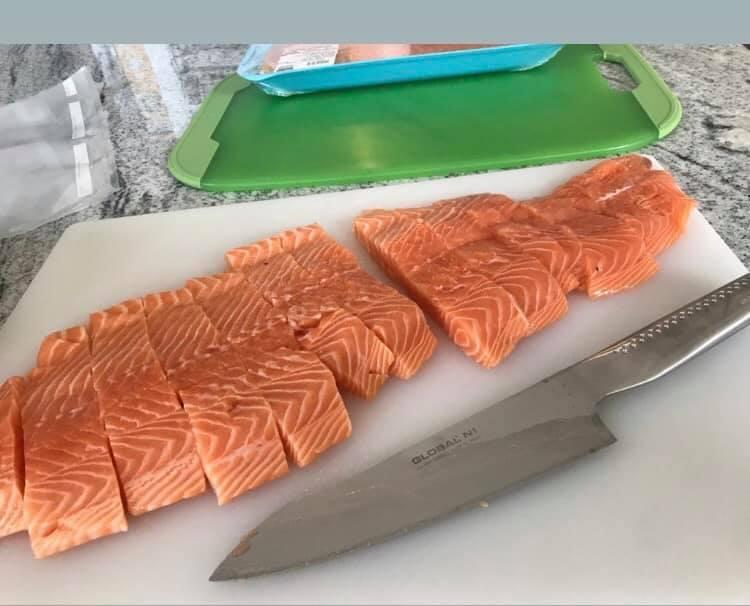 raw salmon cut into filets