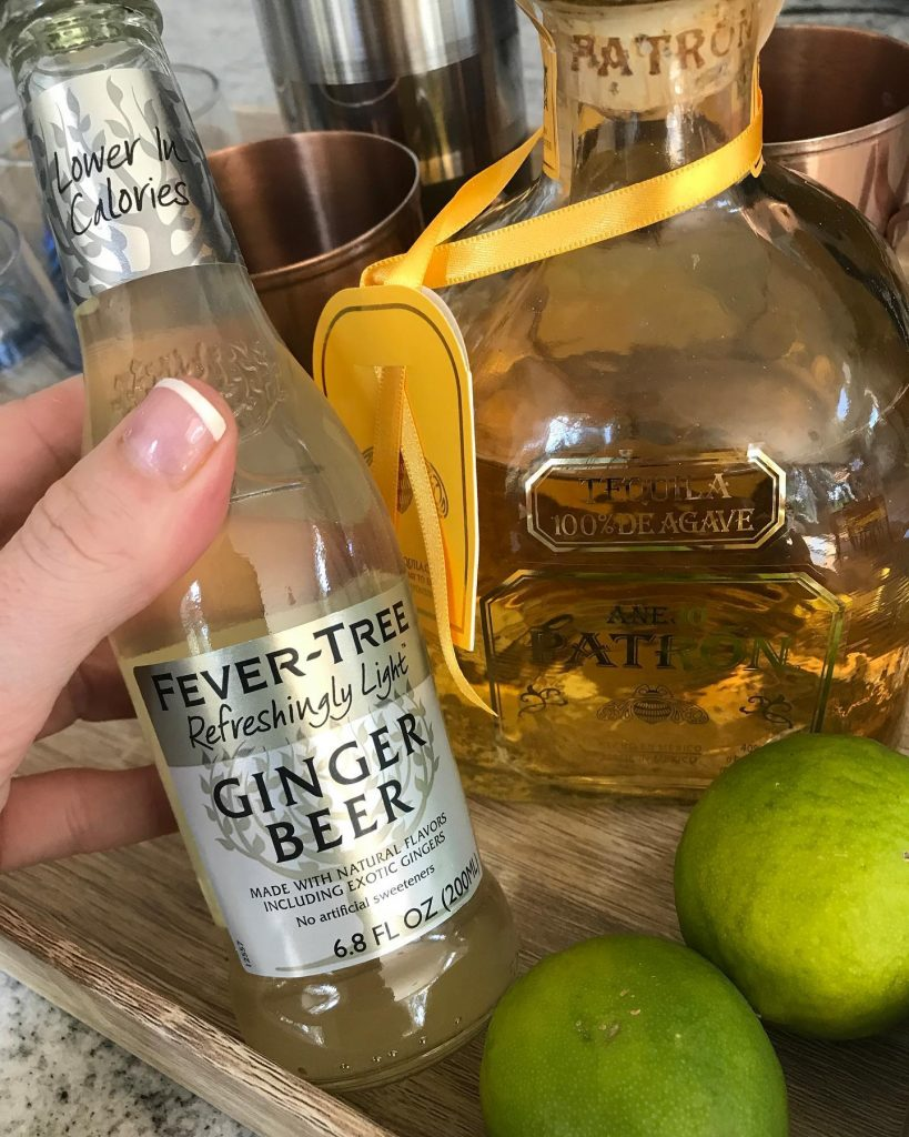 Fever Tree Ginger Beer displayed with 100% Patron Agave Tequila