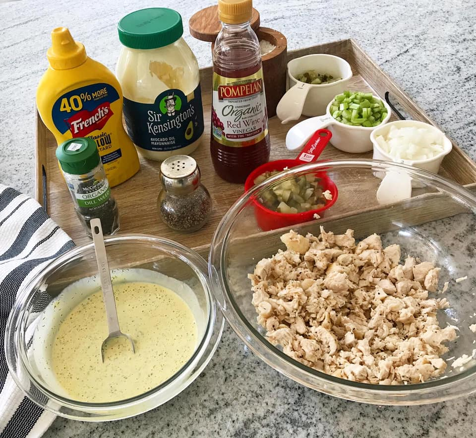 the ingredients displayed on a tray for Easy and Healthy Pickle chicken salad